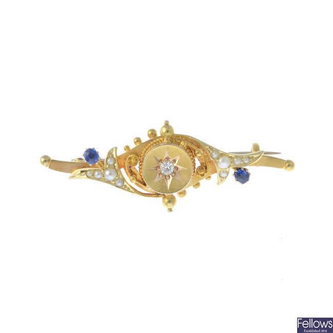 An Edwardian 15ct gold diamond and gem-set bar brooch.