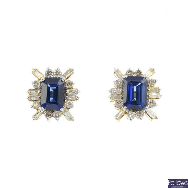 A pair of sapphire and diamond stud earrings.