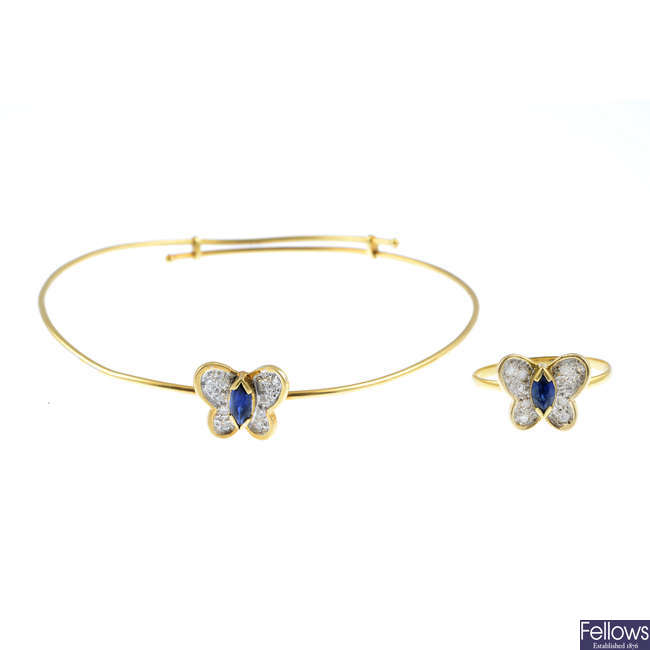 A sapphire and diamond butterfly bangle and a ring.
