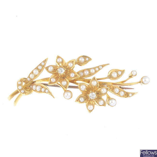 An early 20th century gold, diamond and split pearl floral spray brooch.