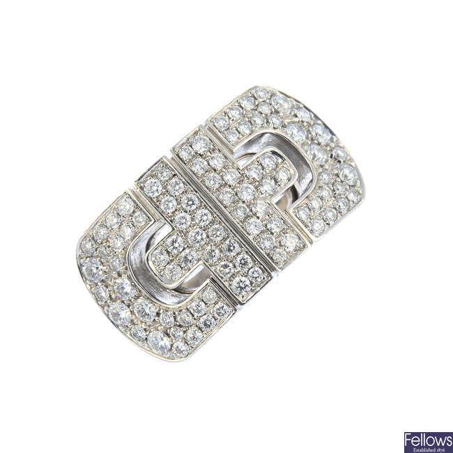 BULGARI - an 18ct gold diamond 'Parentesi' ring.