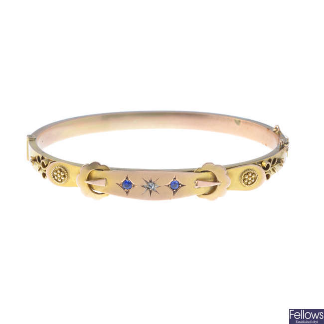 A late Victorian 9ct gold diamond and gem-set hinged bangle.