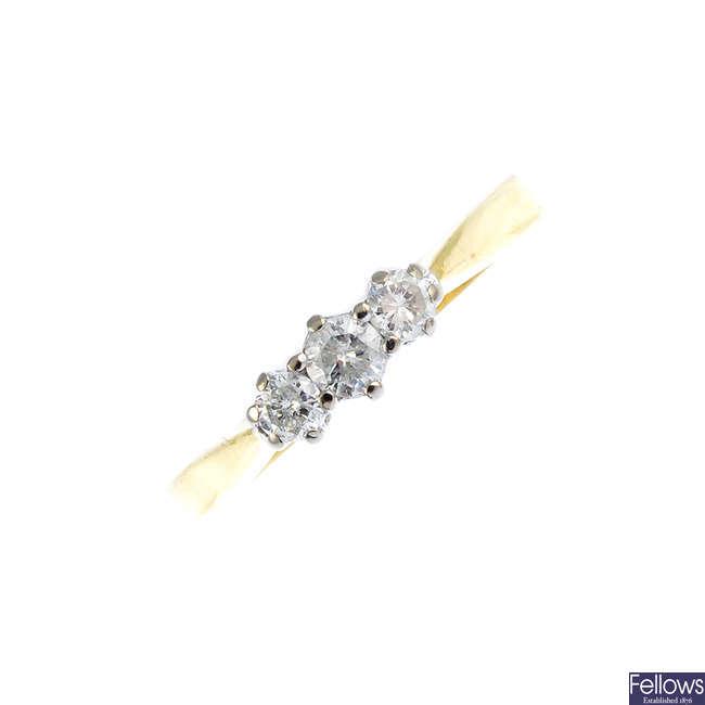 An 18ct diamond three-stone ring.