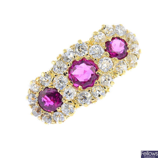 A late Victorian 18ct gold ruby and diamond triple cluster ring.