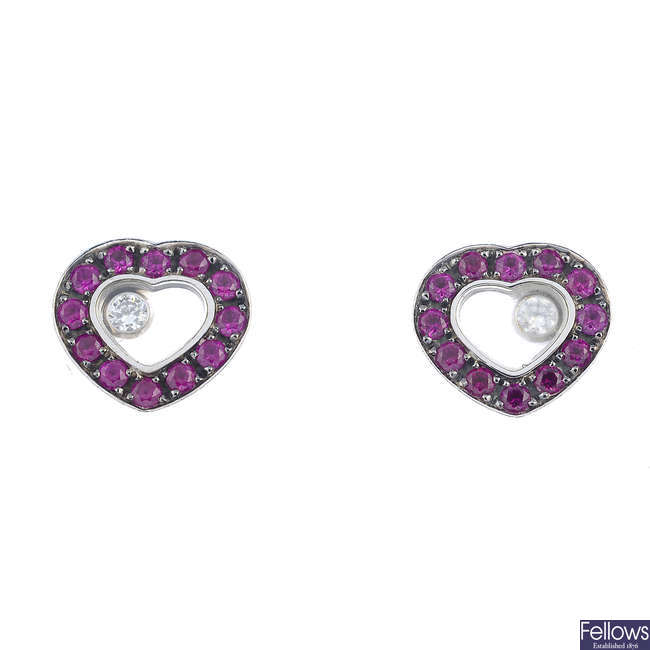 CHOPARD - a pair of 18ct gold ruby and diamond 'Happy Diamonds' earrings.
