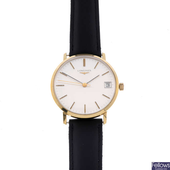 LONGINES - a gentleman's gold plated wrist watch with two Longines watches.