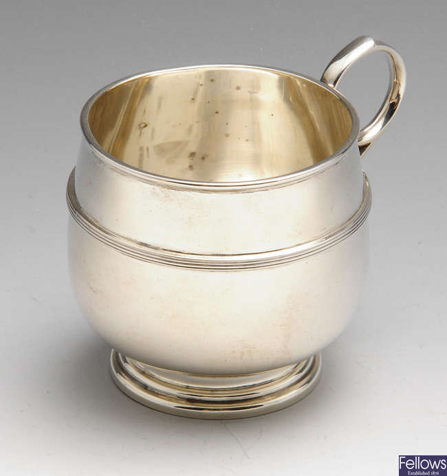 A 1920's silver christening mug.