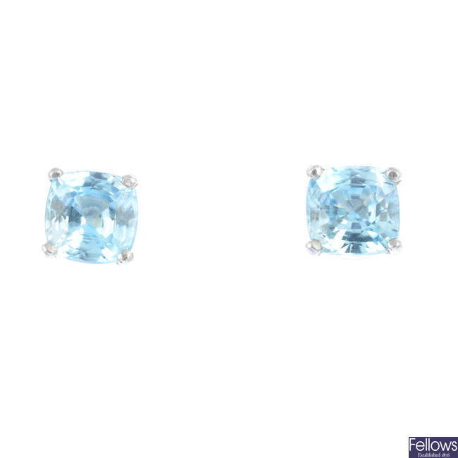A pair of 18ct gold zircon earrings.