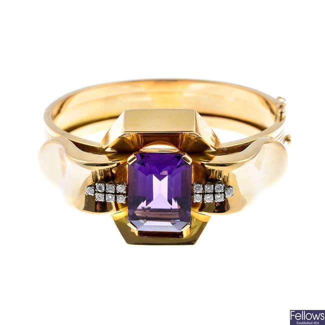 An amethyst and diamond hinged bangle.