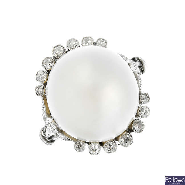 A natural pearl and diamond ring.