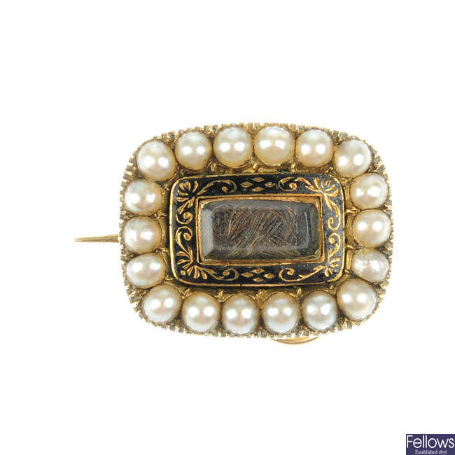 A mid Victorian gold and split pearl memorial brooch.