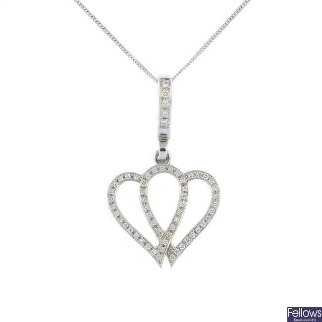 THEO FENNELL - an 18ct gold diamond heart pendant, with non-designer chain.