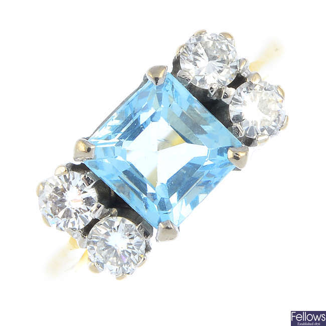 An aquamarine and diamond ring.