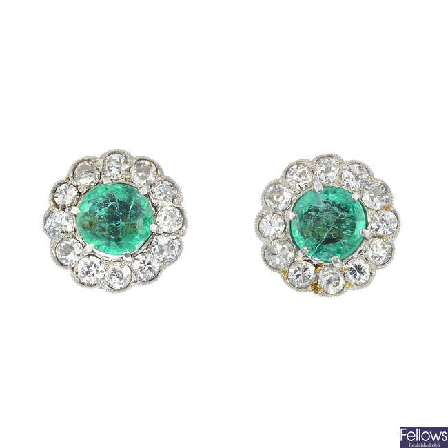 A pair of emerald and diamond earrings.