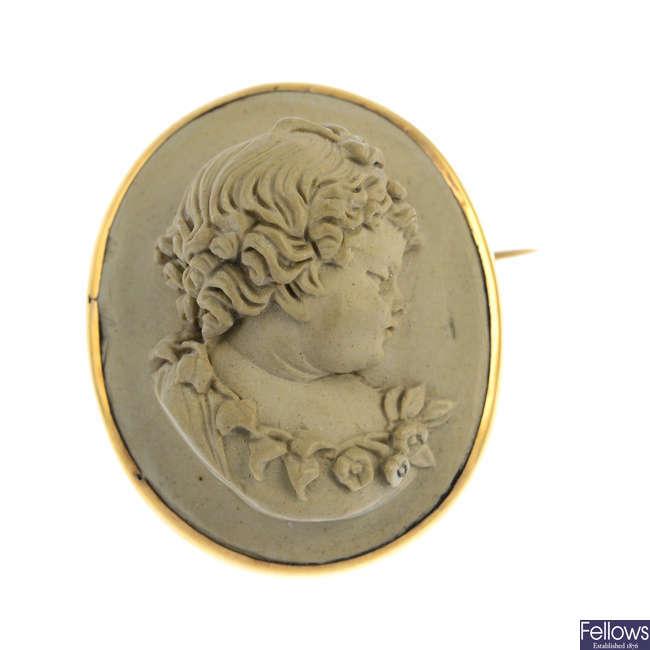 A mid Victorian gold lava cameo brooch.