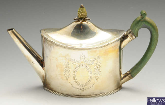 A George III silver teapot by Peter & Ann Bateman.