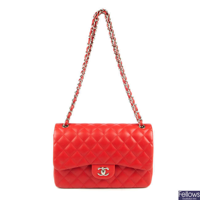 CHANEL - a red Jumbo Classic Double Flap handbag.