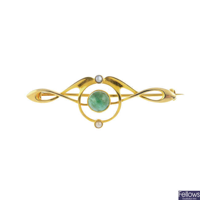 MURRLE BENNETT & CO. - an early 20th century gold, emerald and split pearl brooch.