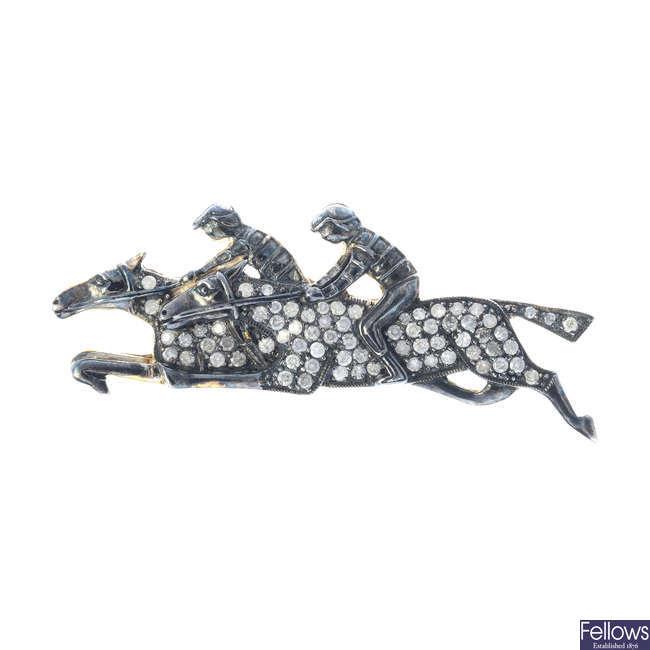 A diamond horse and jockey brooch.