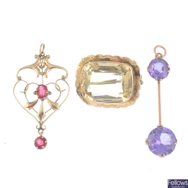 Three gem-set pendants and a brooch.