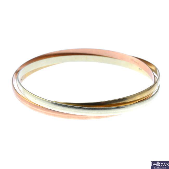 A 9ct gold tri-colour bangle.
