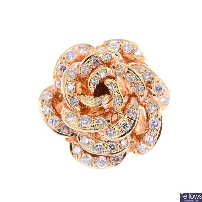 A diamond floral dress ring.