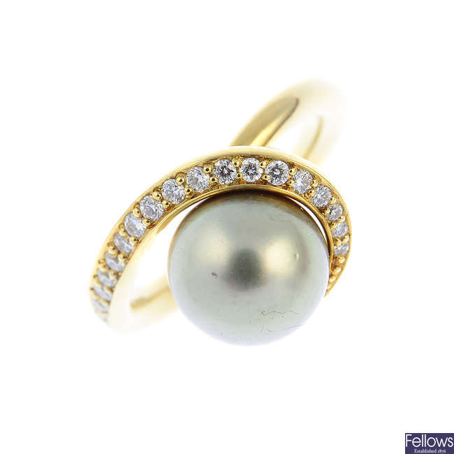 An 18ct gold cultured pearl and diamond dress ring.
