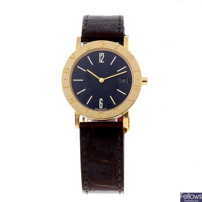 BULGARI - a yellow metal mid-size Bulgari wrist watch.