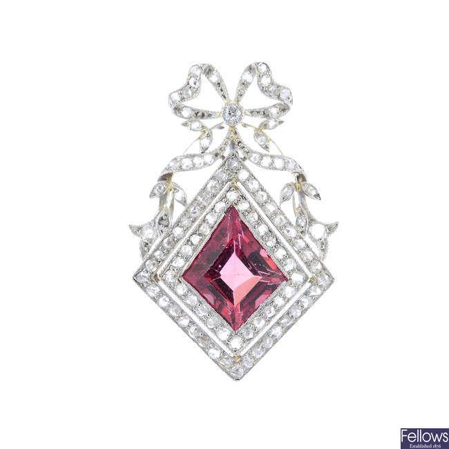 An early 20th century gold tourmaline and diamond pendant.
