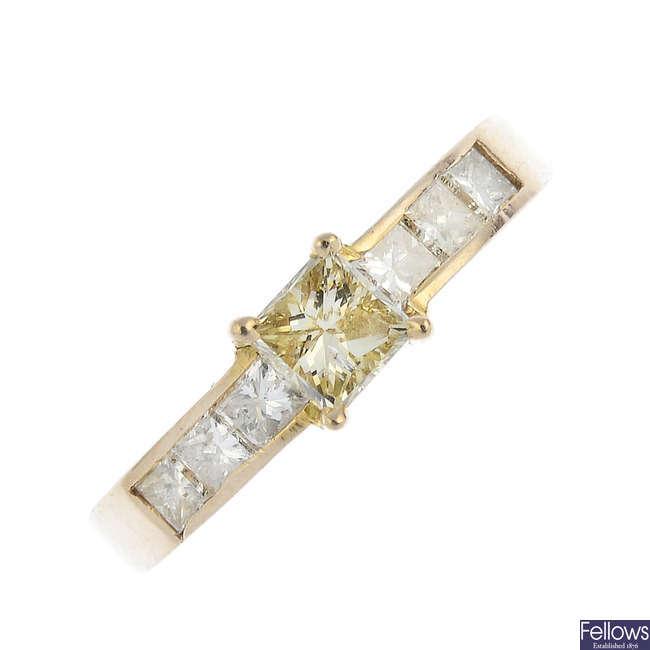 A diamond and 'yellow' diamond dress ring.