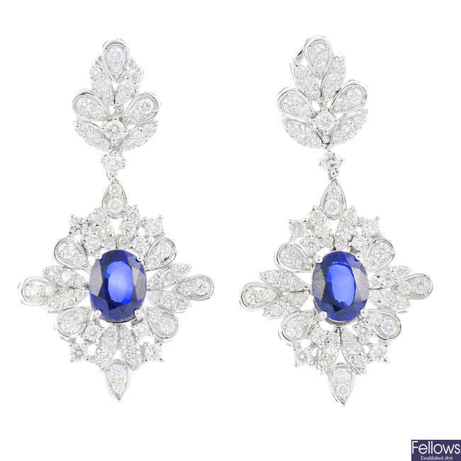 A pair of 18ct gold synthetic sapphire and diamond earrings.