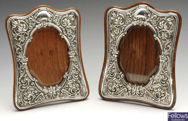 A matched pair of late Victorian and later silver mounted photograph frames.