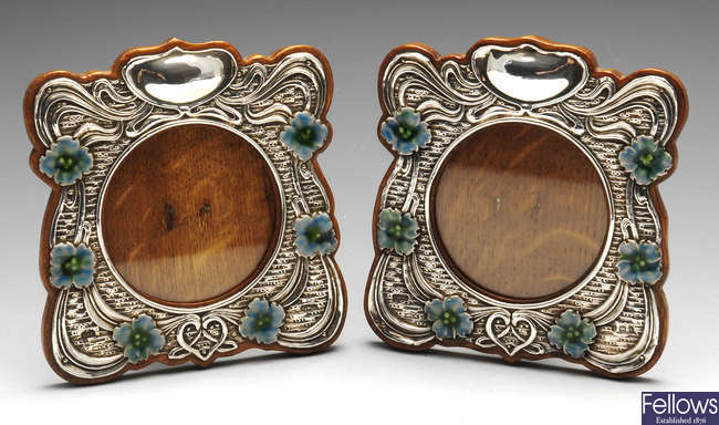 A matched pair of Edwardian silver mounted photograph frames.