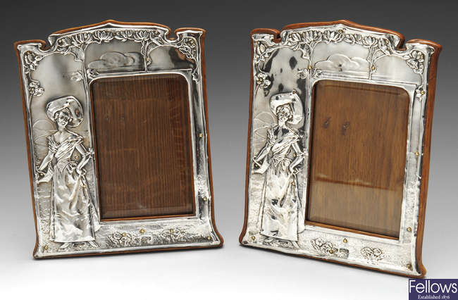 A pair of Edwardian silver mounted photograph frames.