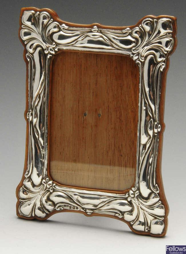 An Edwardian silver mounted photograph frame.