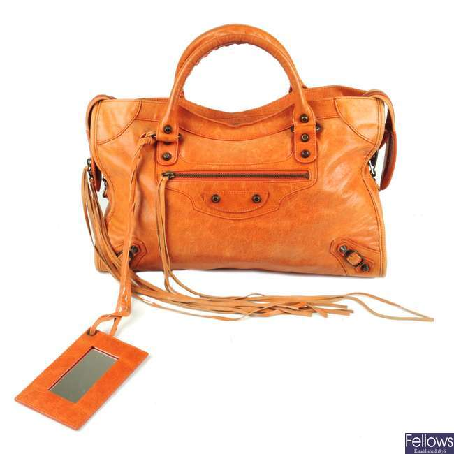BALENCIAGA - an orange Classic City handbag.