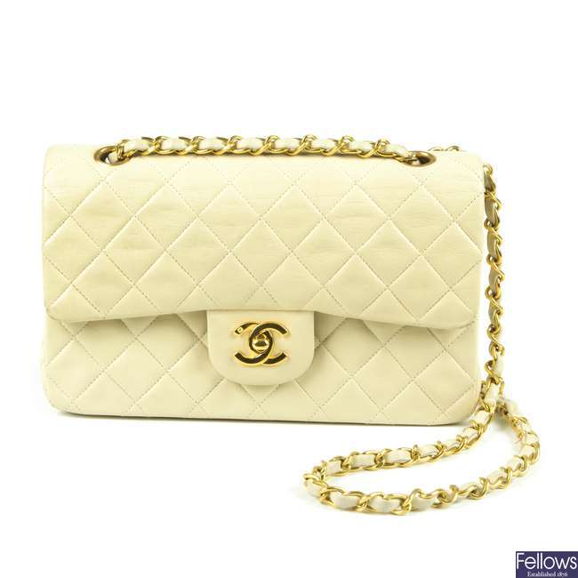 CHANEL - a small cream Classic Double Flap handbag.