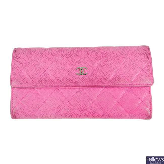 CHANEL - a pink Caviar Flap long wallet.