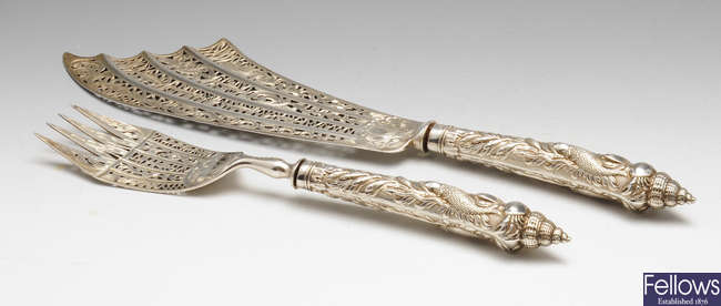 A mid-Victorian pair of silver ornately decorated fish servers.