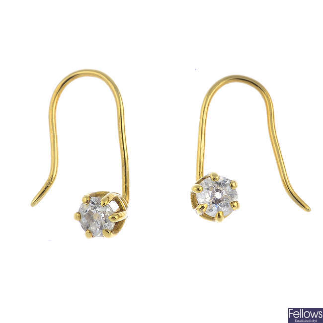 Two pairs of diamond and emerald earrings and a single emerald earring.