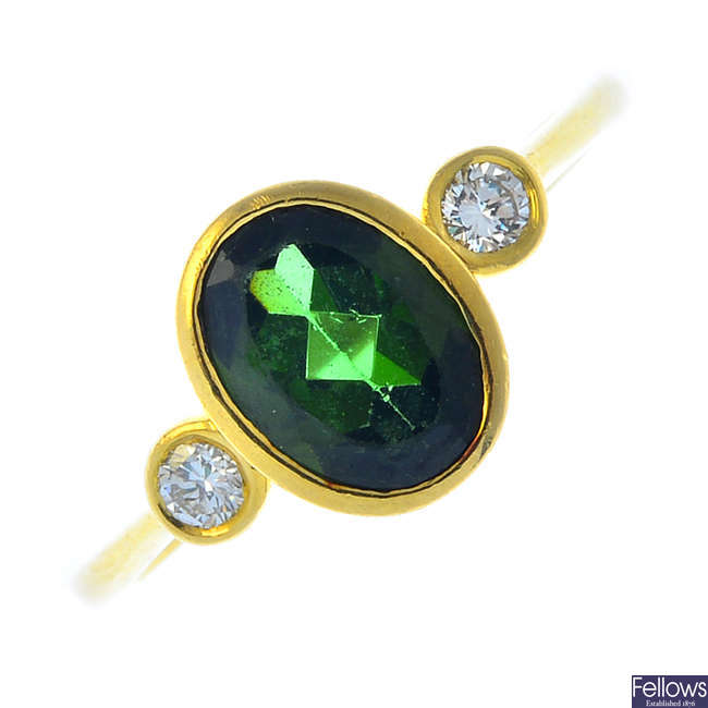 An 18ct gold tourmaline and diamond three-stone ring.