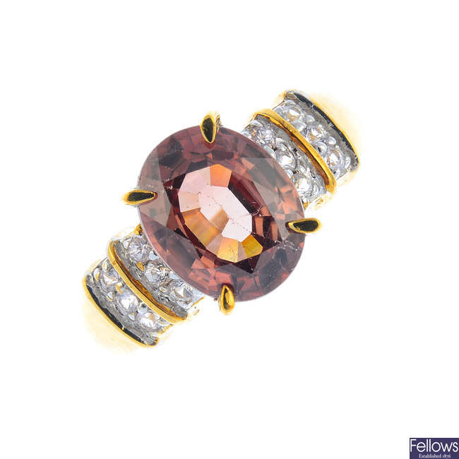 A 9ct gold zircon and diamond ring.