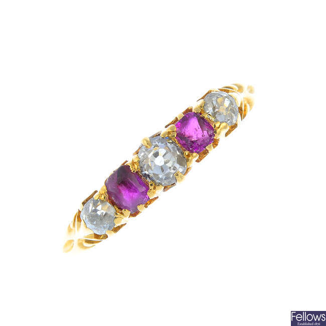 A diamond and ruby five-stone ring.