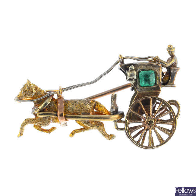 A 1970s 9ct gold emerald horse and carriage brooch.
