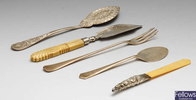 A selection of flatware and cutlery to include a mid-Victorian silver butter spade, etc.