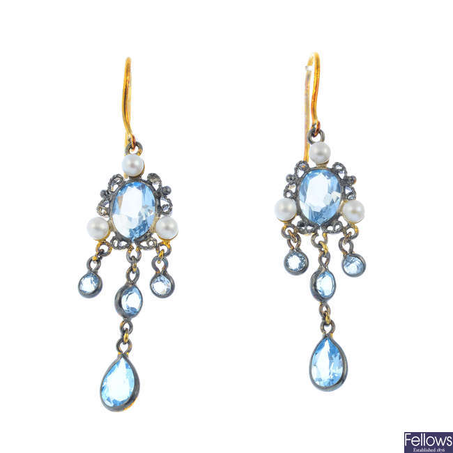 A pair of topaz and seed pearl earrings.