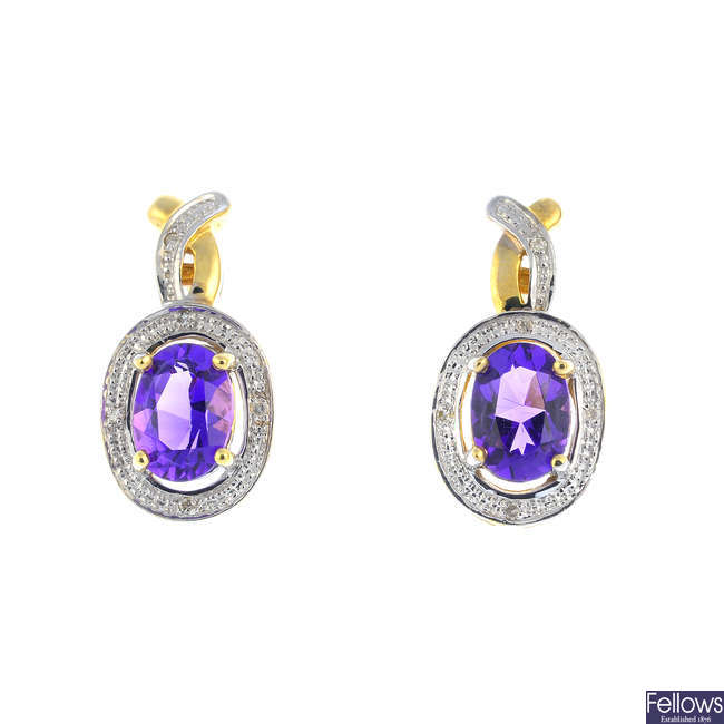 A pair of 9ct gold amethyst and diamond earrings.