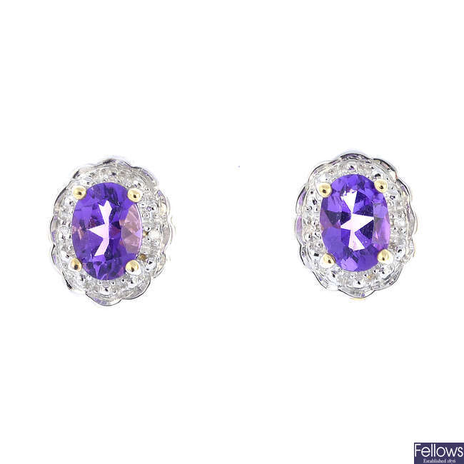 A pair of 9ct gold amethyst and diamond cluster earrings.