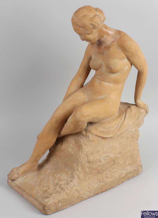A terracotta figure.