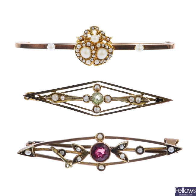 Three early 20th century 9ct gold gem-set brooches.